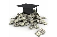graduation cap on a pile of money
