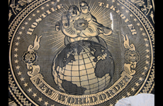 New world order image of hand with eye in the center