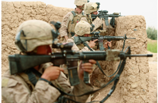 row of soldiers with machine guns aiming at the enemy.
